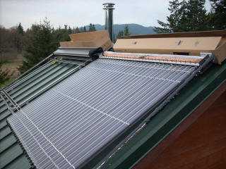 Two evacuated tube collectors being installed on the roof of a Port Angeles area home.