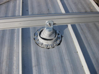On metal roofs Deck-tite style flashings are used over the standard metal standoffs to prevent any roof leaks and ensure a strong attachment can be made to the roof structure. These flashings are warranted for 25 years.