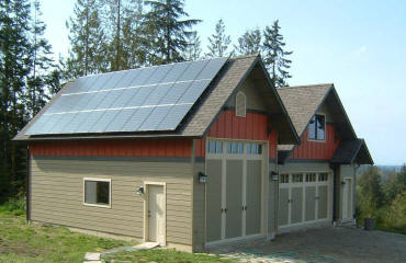6 kw system on garage/ADU in the Sequim Bay area. The garage was located and designed to maximize solar production on the roof.   The roof has an 8:12 pitch and faces due south.  The solar modules are Sanyo 200 watt panels.  30 modules x 200 watts = 6000 watts or 6 kW.