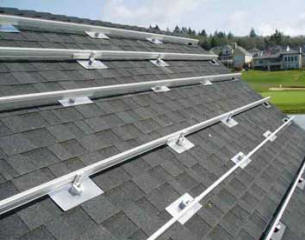 Aluminum rail, standoffs, and heavy duty stainless steel lag bolts hold the solar array to the roof. Flashing and sealant used at each point of roof penetration ensure no leaks on composition asphalt shingle roofs.