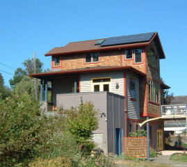 Jeff and Shelly Randall's home in Port Townsend utilizes their west facing roof to generate electricity from the sun with a 2 kW PV system.